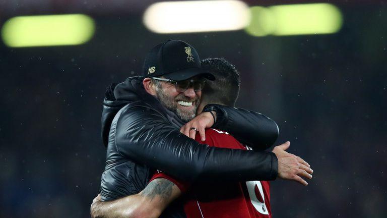 Jurgen Klopp embraces Dejan Lovren after Liverpool's win