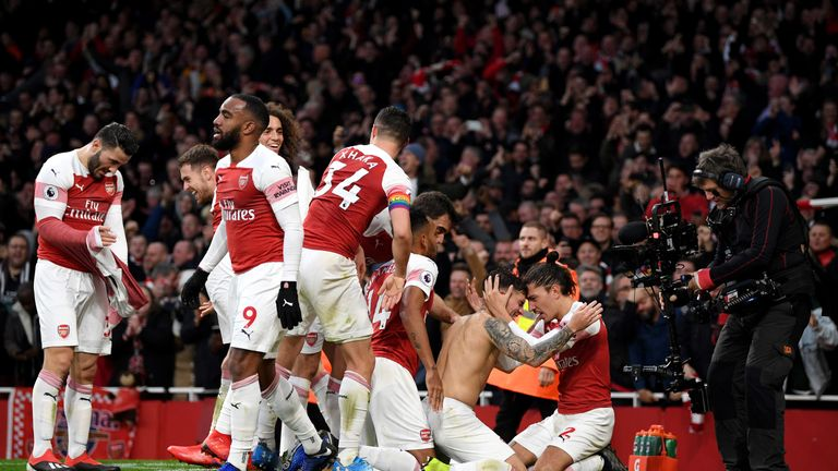 Lucas Torreira celebrates with team-mates after scoring Arsenal's fourth goal