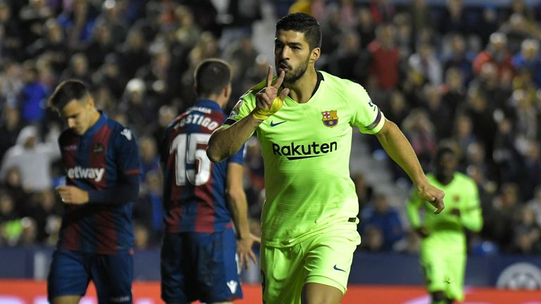 Luis Suarez celebrates breaking the deadlock for Barcelona on Sunday evening