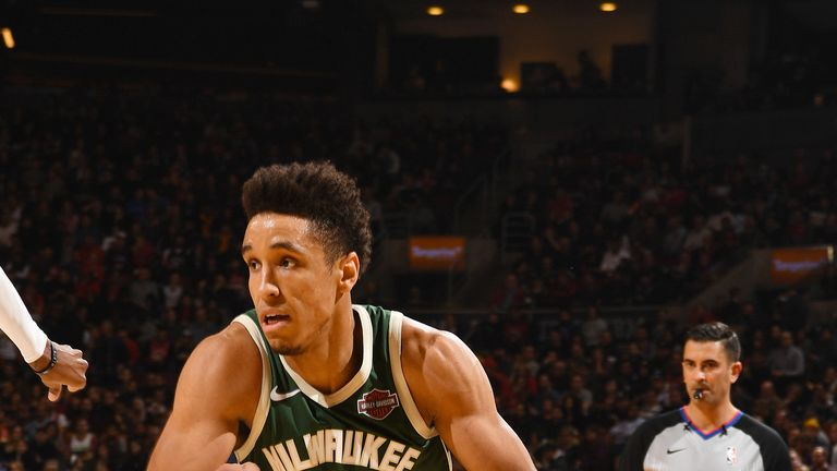 Malcolm Brogdon #13 of the Milwaukee Bucks handles the ball during the game against Delon Wright #55 of the Toronto Raptors on December 9, 2018 at the Scotiabank Arena in Toronto, Ontario, Canada.