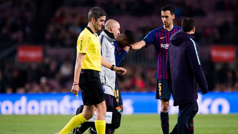 Sergio Busquets comforts Malcom when coming off injured for Barcelona against Cultural Leonesa