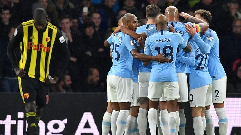 Manchester City players celebrate Leroy Sane's opener against Watford