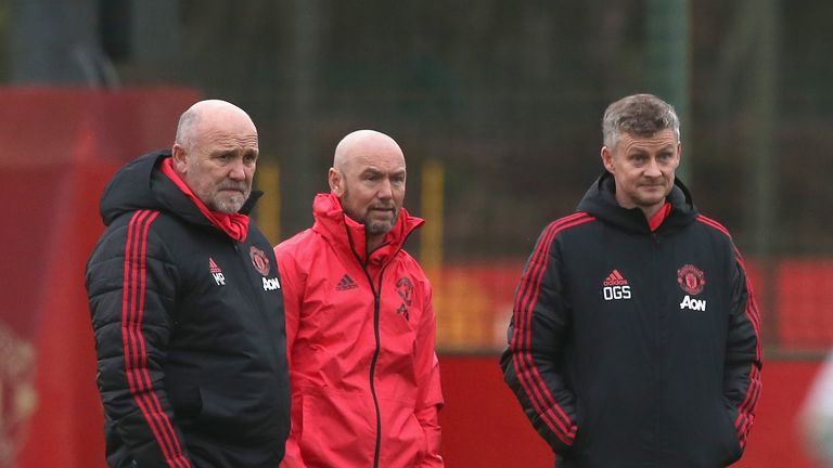 Mark Dempsey observes training alongside Ole Gunnar Solskjaer at United's Aon Training Complex
