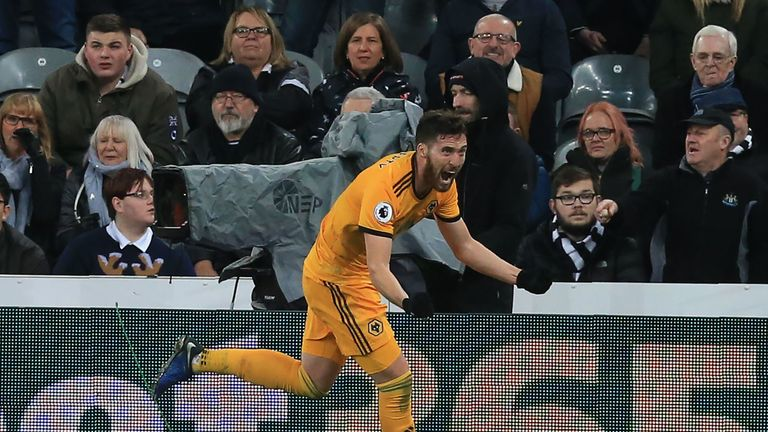 Wolverhampton Wanderers' Irish defender Matt Doherty celebrates after scoring their late winner during the English Premier League football match between Newcastle United and Wolverhampton Wanderers at St James' Park in Newcastle-upon-Tyne, north east England on December 9, 2018. - Wolves won the game 2-1.