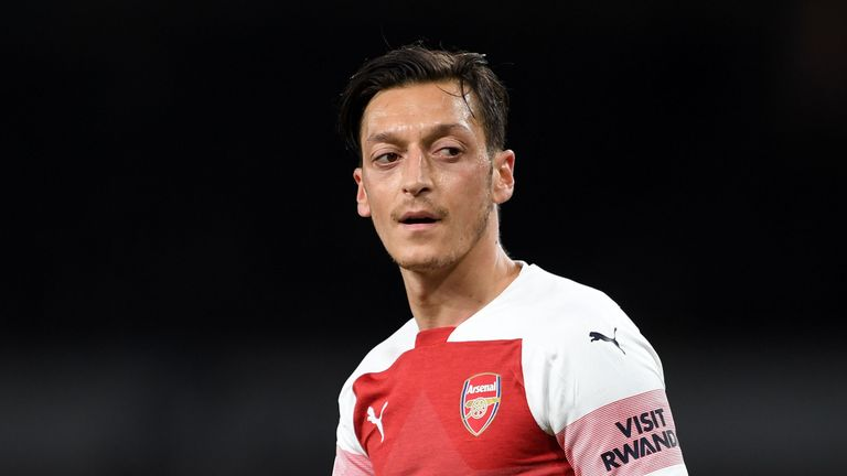 Mesut Ozil has been struggling with a back spasm in recent weeks