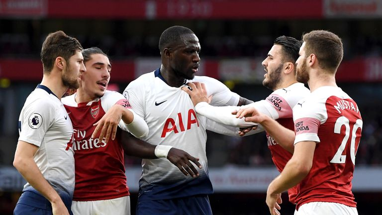 Moussa Sissoko and Sead Kolasinac clash during the north London derby
