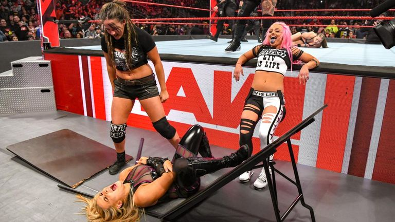 Natalya's night ended early thanks to a vicious table attack by the Riott Squad