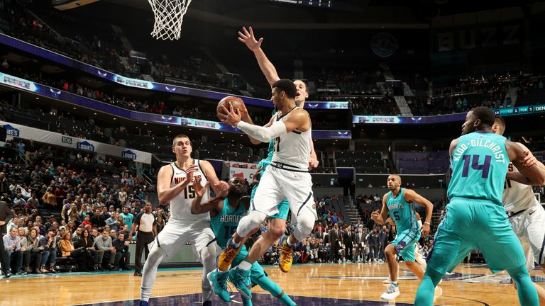 Jamal Murray of the Denver Nuggets passes the ball against the Charlotte Hornets