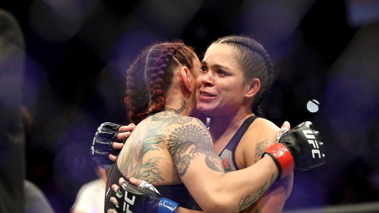 Cris Cyborg of Brazil (left) hugs Amanda Nunes of Brazil (right) after being defeated by TKO