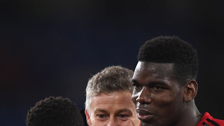 Ole Gunnar Solskjaer and Paul Pogba celebrate after the win over Huddersfield