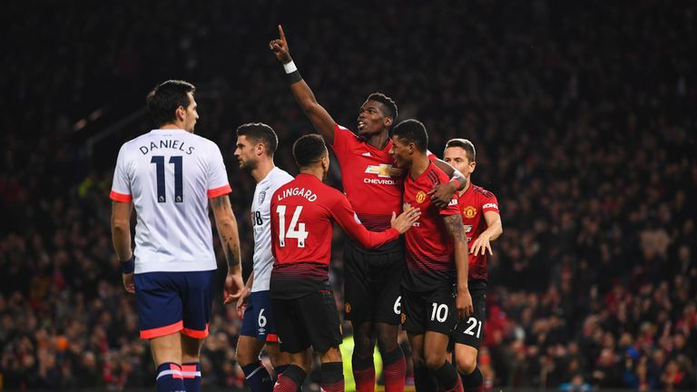 Pogba celebrates his early goal with team-mates