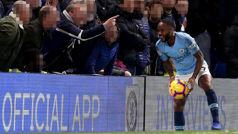 Raheem Sterling collects the ball from pitchside at Stamford Bridge