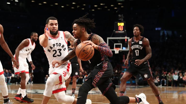 D'Angelo Russell of the Brooklyn Nets drives against Fred VanVleet of the Toronto Raptors during their game on December 07