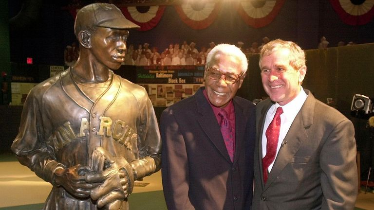 Satchel Paige's statue stands at the Negro Leagues Baseball Museum in Kansas City, where President George W. Bush was guided around by Negro league great Buck O'Neil