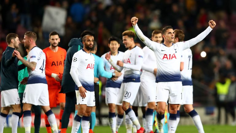 Erik Lamela leads Tottenham's celebrations after the 1-1 draw at Barcelona secured qualification for the last 16 of the Champions League