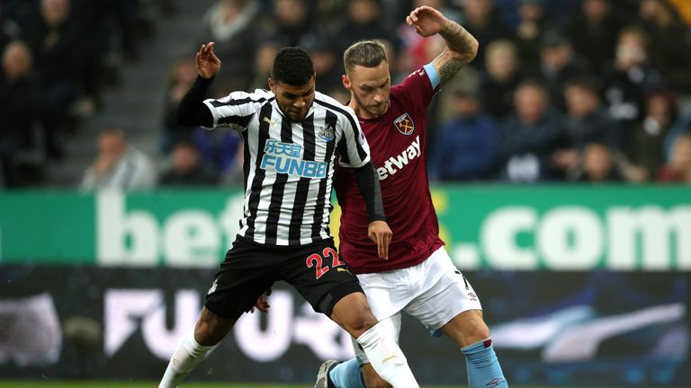 Newcastle's DeAndre Yedlin is challenged by Marko Arnautovic