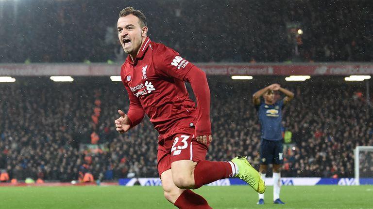 Xherdan Shaqiri celebrates after scoring Liverpool's second goal