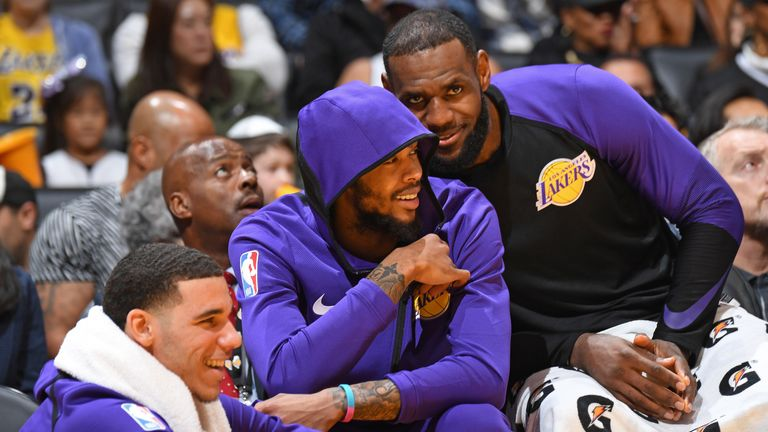 LeBron James photobombs Ingram on the Lakers' bench