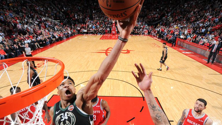 Giannis Antetokounmpo converts a crucial tip-in