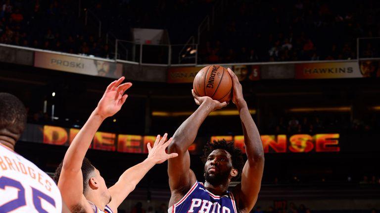 Joel Embiid lofts a jump shot against Phoenix