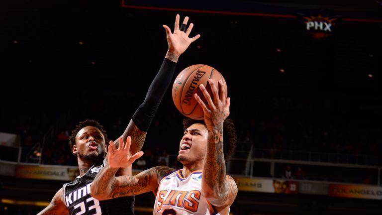 Kelly Oubre Jr attacks the basket against Sacramento