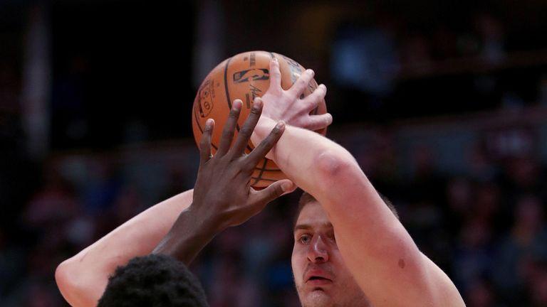 Nikola Jokic looks to pass against Chicago