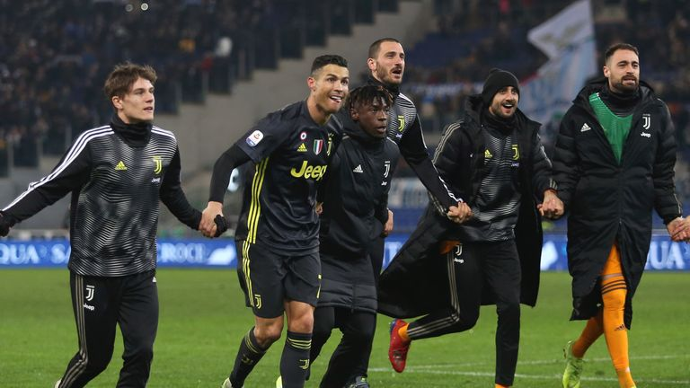 Cristiano Ronaldo with his team-mates after Juventus' win