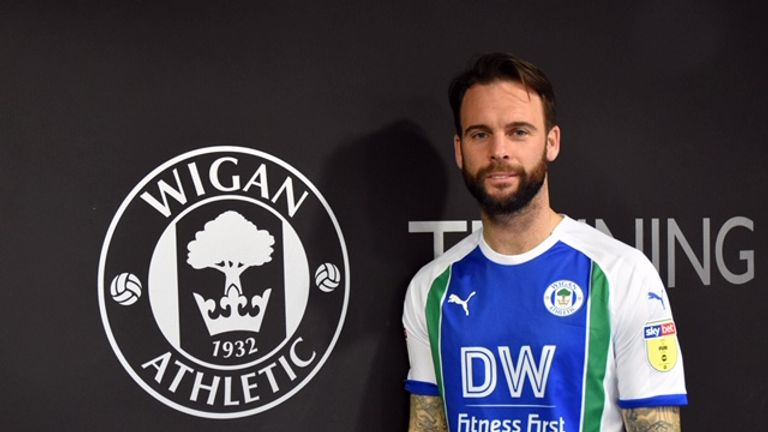Danny Fox has joined Wigan from Nottingham Forest