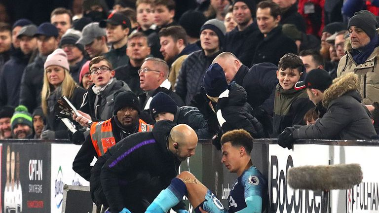 Dele Alli receives treatment before being substituted against Fulham