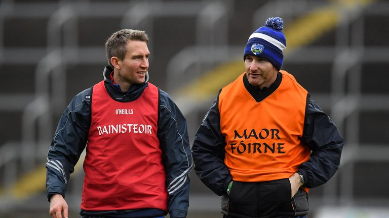 Behind enemy lines: Former Dublin hurler and current Laois strength & conditioning coach Niall Corcoran joined Eddie Brennan on the O'Moore County's sideline against the Dubs