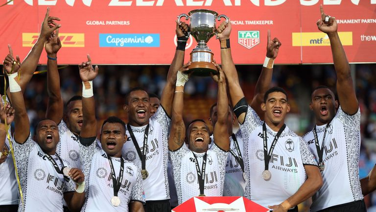 Fiji players celebrate with the trophy after winning the cup final in Hamilton on Sunday