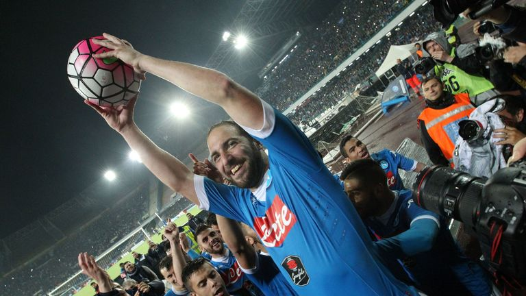 Higuain holds aloft the match ball which helped him break the Serie A goalscoring record