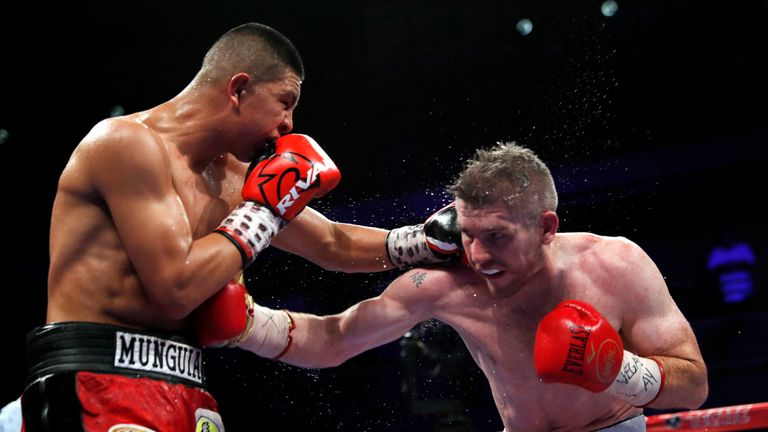 Liam Smith believes a lack of momentum proved his downfall against Jaime Munguia (L)