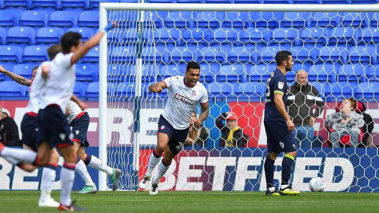 Bolton's Josh Magennis celebrates his hat-trick against Walsall