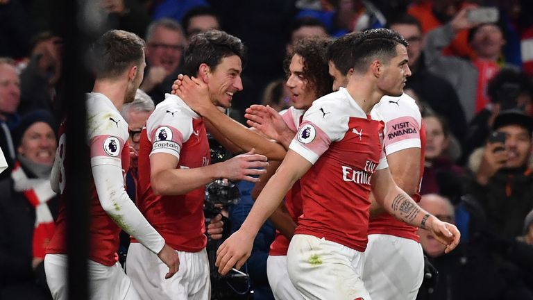 Laurent Koscielny celebrates with his Arsenal team-mates