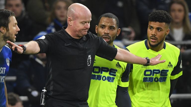 Referee Lee Mason overturns his initial decision to award Huddersfield a second-half penalty