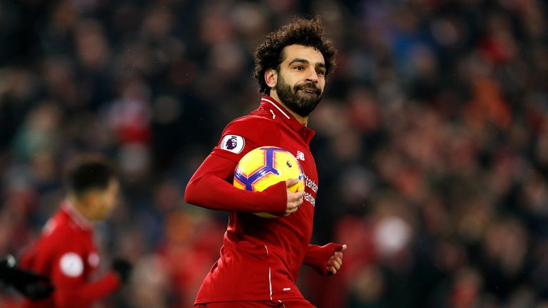 Liverpool's Mohamed Salah celebrates scoring his side's first goal
