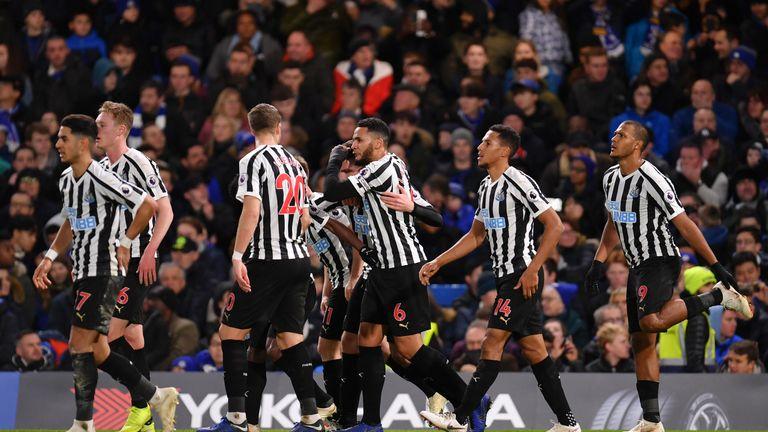 Newcastle celebrate Ciaran Clark's goal at Stamford Bridge