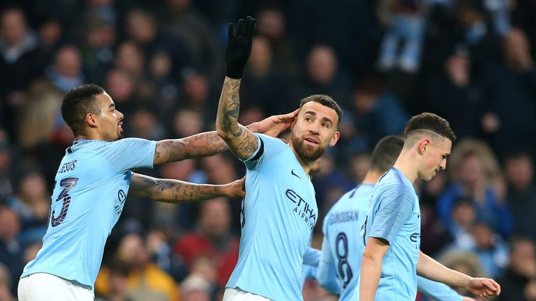 Nicolas Otamendi (C) celebrates scoring against Rotherham