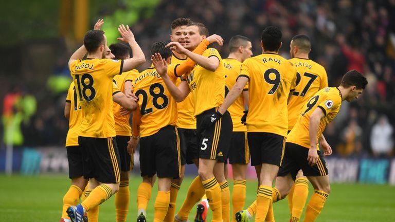 Wolves defender Ryan Bennett celebrates his goal with team-mates