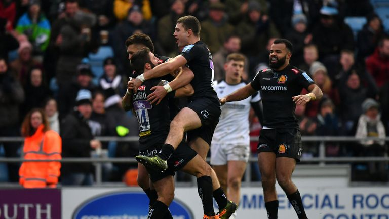 Santiago Cordero celebrates with Exeter team-mates after scoring a try