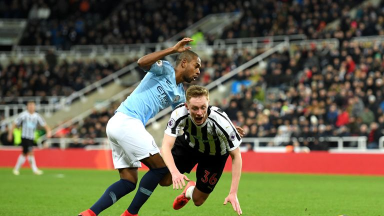 Sean Longstaff is fouled in the penalty area by Fernandinho