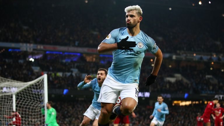 Sergio Aguero thumps his chest in celebration after making it 1-0