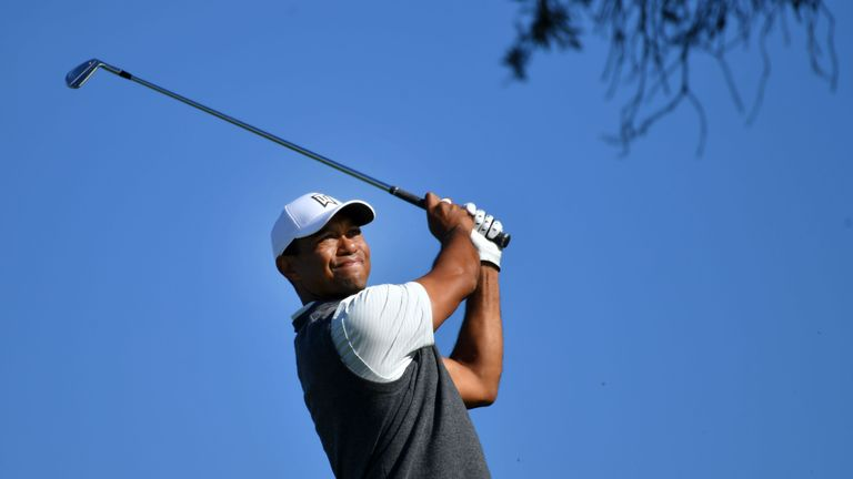 Woods finds a consolation prize without contending at Torrey