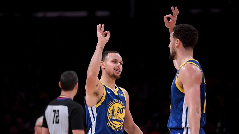 Stephen Curry and Klay Thompson celebrate a basket against the Los Angeles Lakers