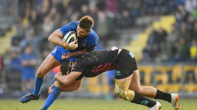 Ross Byrne of Leinster is tackled by Giovanni Licata of Zebre