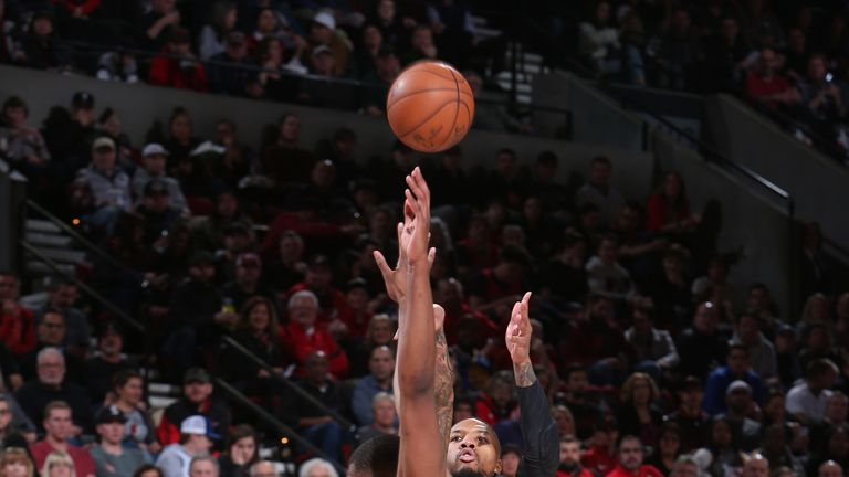 Damian Lillard fires a contested jump shot against Golden State