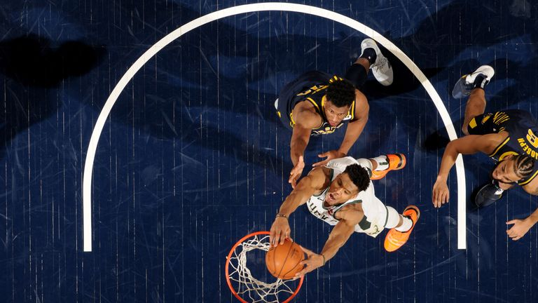 Giannis Antetokounmpo slams home a dunk on the way to a triple-double against the Indiana Pacers