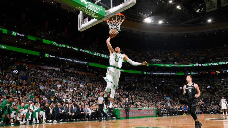 Jayson Tatum dunks against the Detroit Pistons