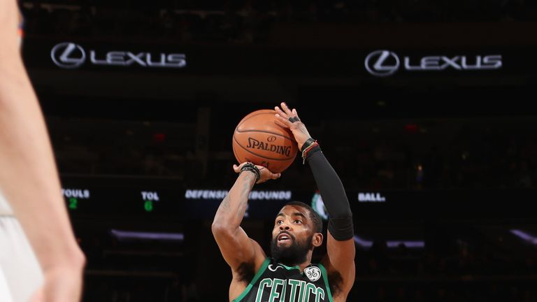 Kyrie Irving fires a jump shot against the New York Knicks